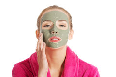 Relaxed woman with a nourishing face mask Royalty Free Stock Images