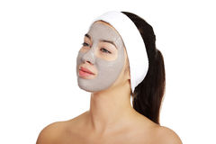 Relaxed woman with a nourishing face mask Royalty Free Stock Photo