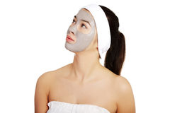 Relaxed woman with a nourishing face mask Stock Photo