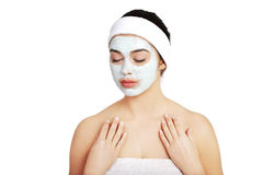 Relaxed woman with a nourishing face mask Stock Images
