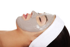 Relaxed woman with a nourishing face mask Stock Photography