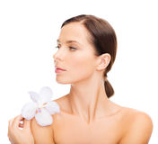 Relaxed woman with orchid flower Royalty Free Stock Image