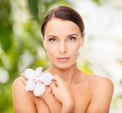 Relaxed woman with orchid flower Royalty Free Stock Photos