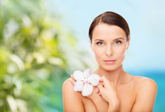 Relaxed woman with orhid flower Royalty Free Stock Photography