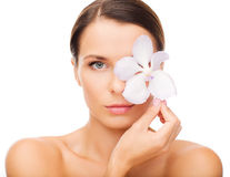 Relaxed woman with orсhid flower over eye Stock Photography