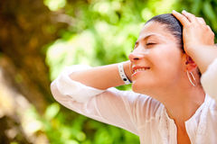 Relaxed woman outdoors Stock Images