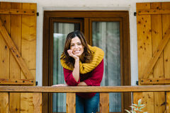 Relaxed woman outside home on autumn Stock Image