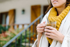 Relaxed woman outside home drinking coffee on autumn Stock Images