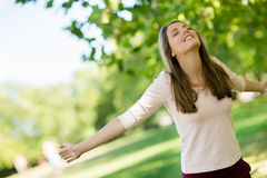 Relaxed woman at the park Stock Photo