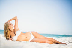 Relaxed woman posing at the beach Stock Photos