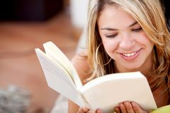 Relaxed woman reading Royalty Free Stock Image