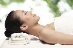 Relaxed woman ready for a massage Royalty Free Stock Photo