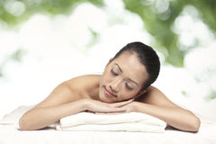 Relaxed woman ready for a massage Stock Photo