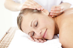 Relaxed woman receiving an acupuncture treatment Stock Images
