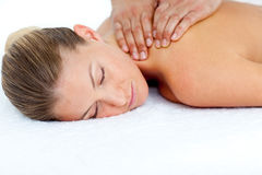Relaxed woman receiving a back massage Royalty Free Stock Image