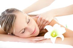Relaxed woman receiving a back massage