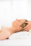 Relaxed Woman Receiving Head Massage At Health Spa Royalty Free Stock Photo