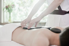 Relaxed Woman Receiving Hot Stone Massage Royalty Free Stock Image