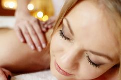Relaxed woman receiving a massage in a spa Stock Photos