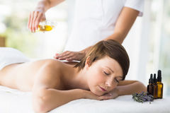 Free Relaxed Woman Receiving Massage Treatment Royalty Free Stock Photo - 77700655