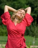 Relaxed woman in red dress Stock Photography