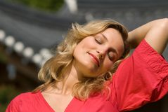 Relaxed woman in red dress Stock Photo