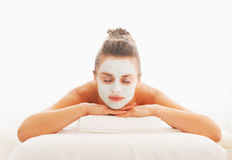 Relaxed woman with revitalising mask on face Stock Photos
