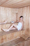 Relaxed woman in sauna Royalty Free Stock Photography