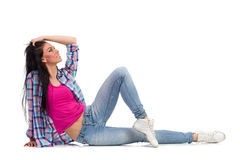 Relaxed woman sitting on the floor Royalty Free Stock Photos