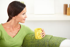 Relaxed woman sitting and looking away Royalty Free Stock Photo