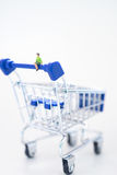 Relaxed woman sitting on shopping cart. Royalty Free Stock Images