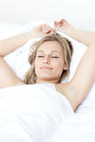 Relaxed woman sleeping on a bed Stock Photo