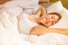 Relaxed woman sleeping in bed Royalty Free Stock Images