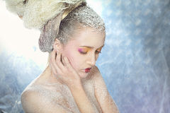 Relaxed woman in the snow. Relaxed with the original hair woman in the snow Royalty Free Stock Photo