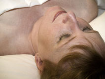 Relaxed woman at spa. Close-up of a woman lying on a spa bed with her eyes closed waiting for a treatment Stock Photography