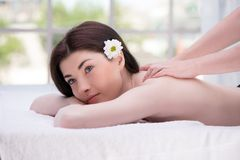 Relaxed woman in spa center enjoying massage Stock Photo