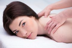 Relaxed woman in spa center enjoying massage Royalty Free Stock Images