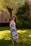 Relaxed woman standing grass tree, Groot Begijnhof, Leuven, Belgium royalty free stock image