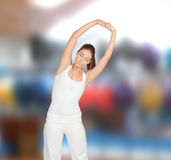 Relaxed woman stretching her arms Royalty Free Stock Photos