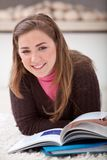Relaxed woman studying Stock Images