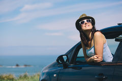 Relaxed woman on summer car road trip vacation stock photo