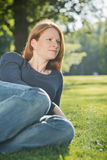 Relaxed Woman in a Summer Park Stock Photo