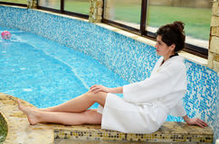 Relaxed woman  sunbathing at swimming pool Stock Photography