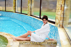 Relaxed woman  sunbathing at swimming pool Stock Photos
