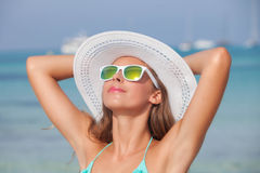 Relaxed woman in sunshine on beach Stock Photography
