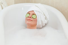 Relaxed woman taking a bath Royalty Free Stock Image