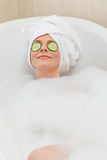 Relaxed woman taking a bath Stock Photography