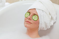Relaxed woman taking a bath Royalty Free Stock Images
