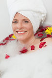 Relaxed woman taking a relaxing bath Stock Photos