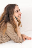 Relaxed woman talking on the phone Royalty Free Stock Photography